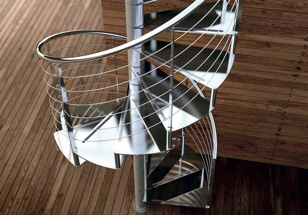 Escalera de caracol modelo Ferro Inox con peldaños de metal y barandilla modelo R4(1) de Enesca.es
