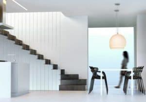 Escalera de tramos modelo Glam Laser con peldaños de metal continuo y barandilla modelo R104
